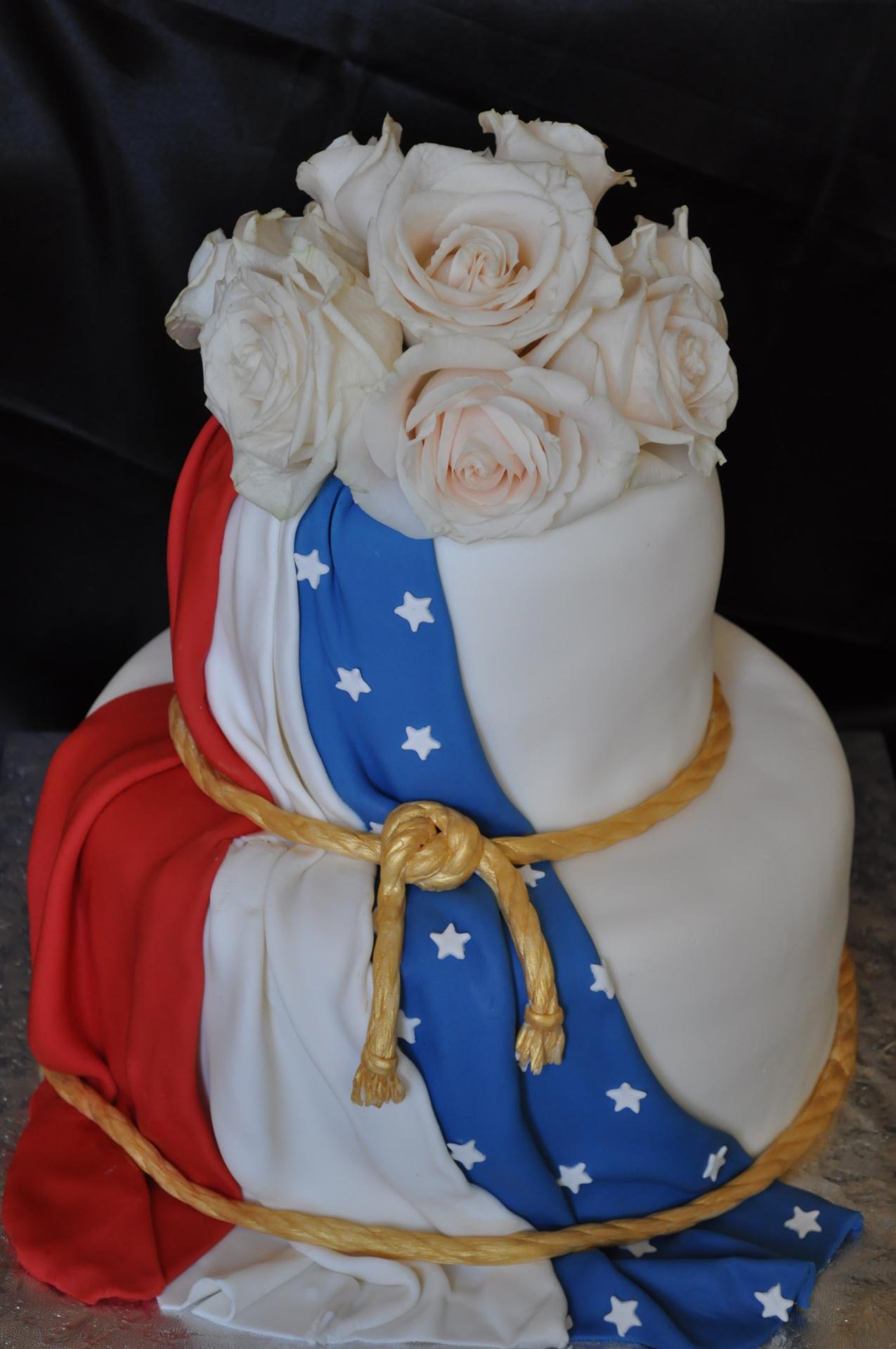 Flag drape cake with white roses for memorial
