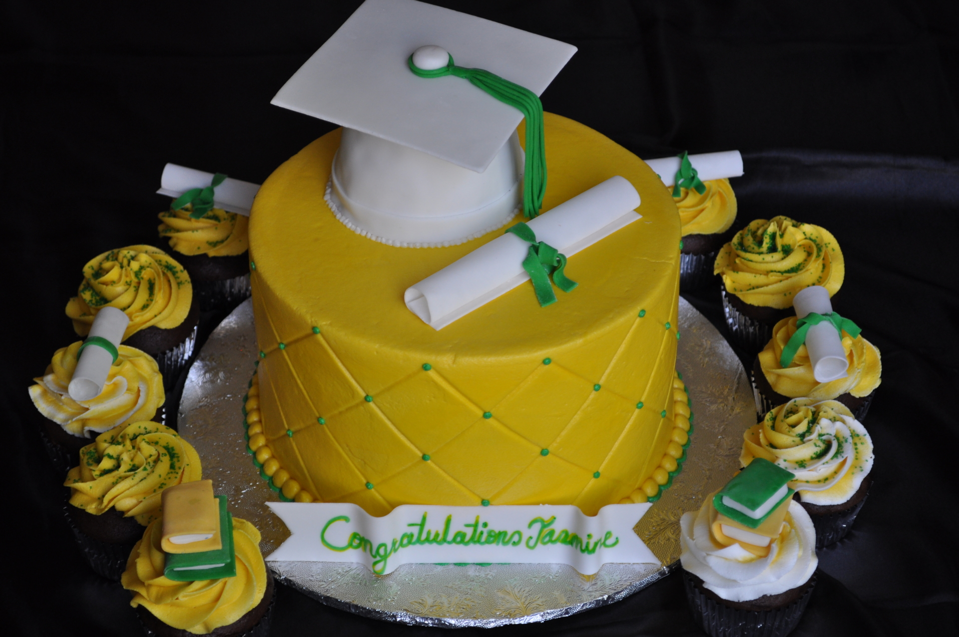Graduation hat diploma and cupcakes in yellow and green