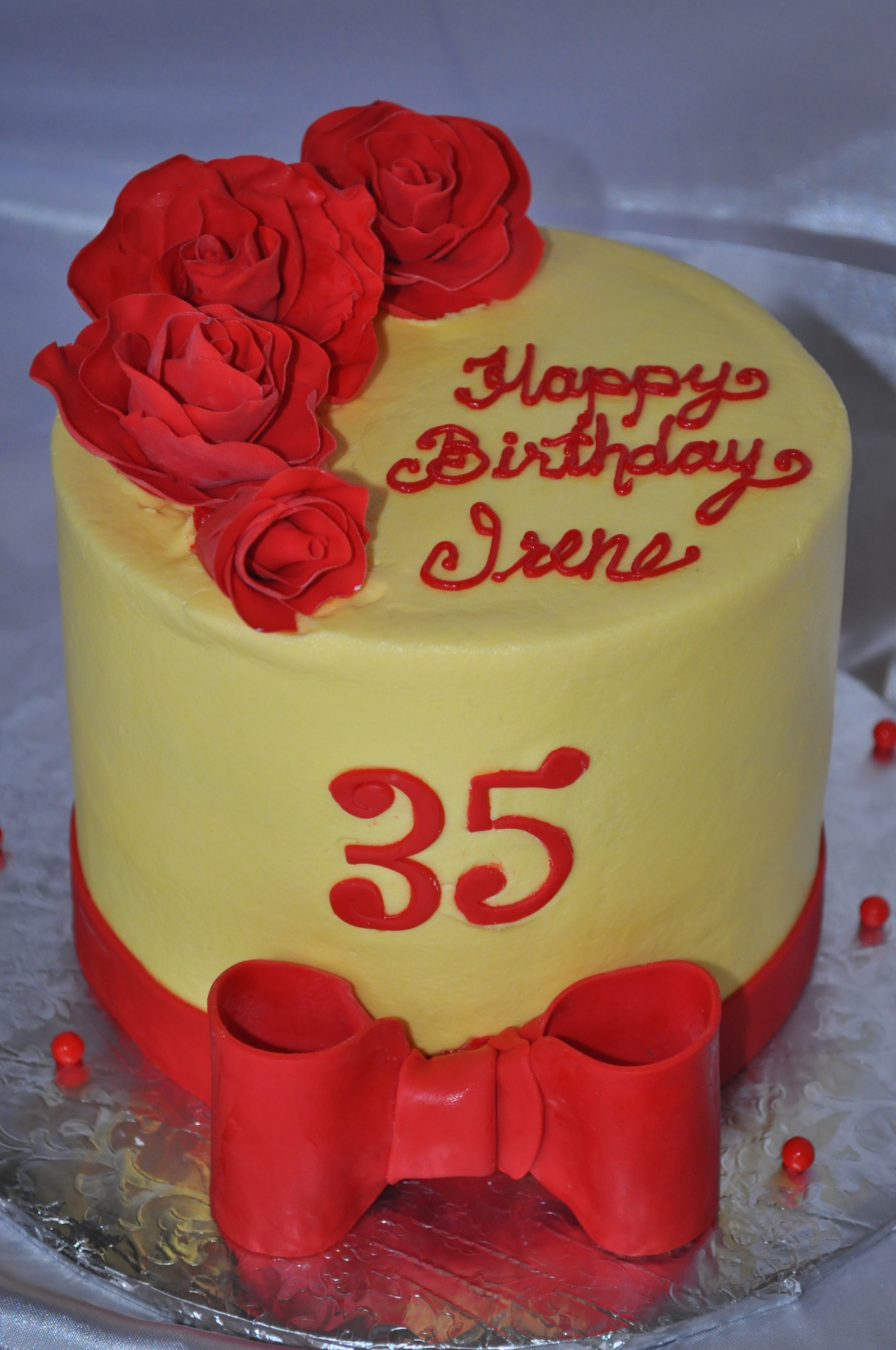 Yellow with red sugar roses and bow