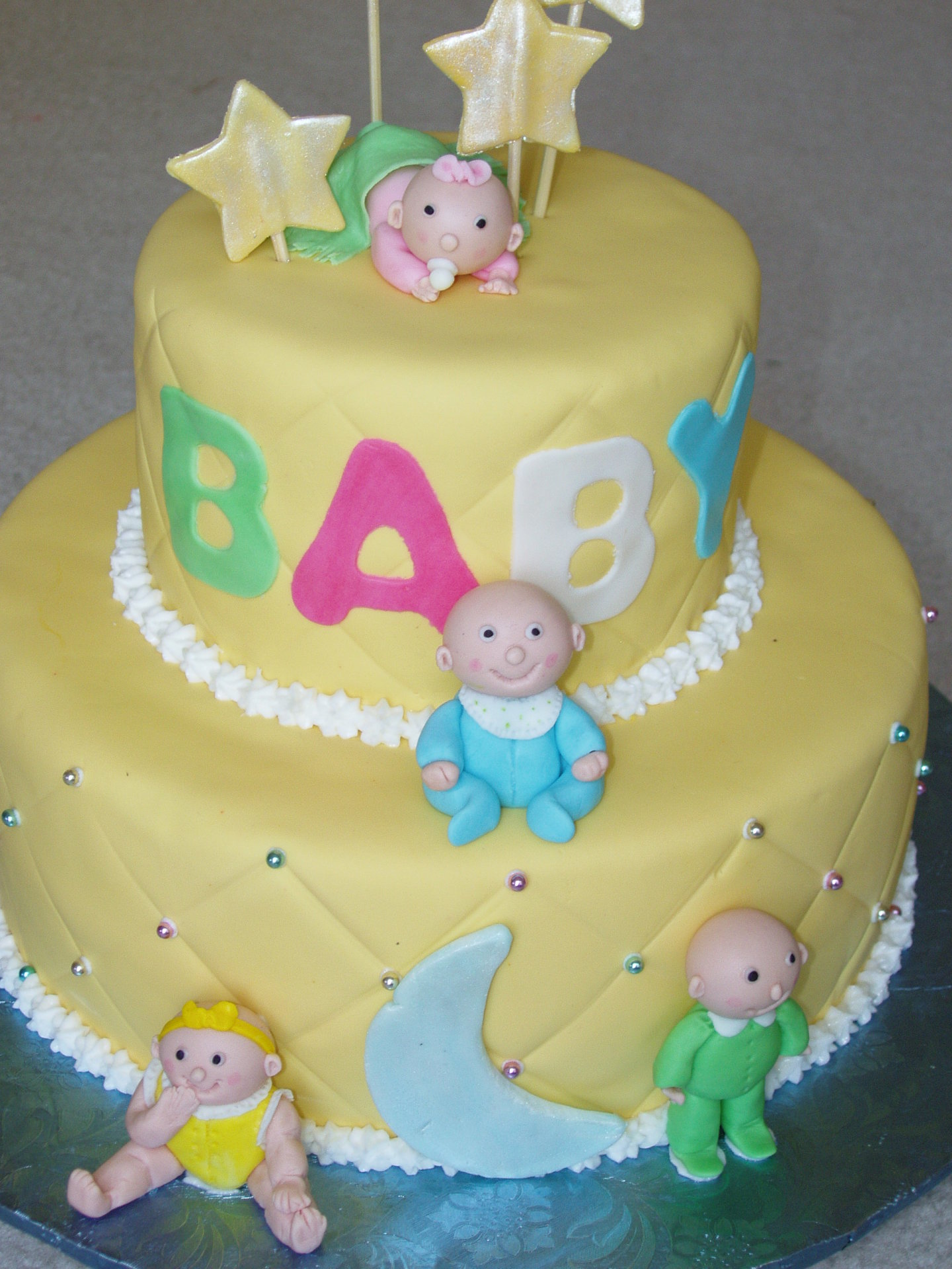 Yellow fondant with fondant babies