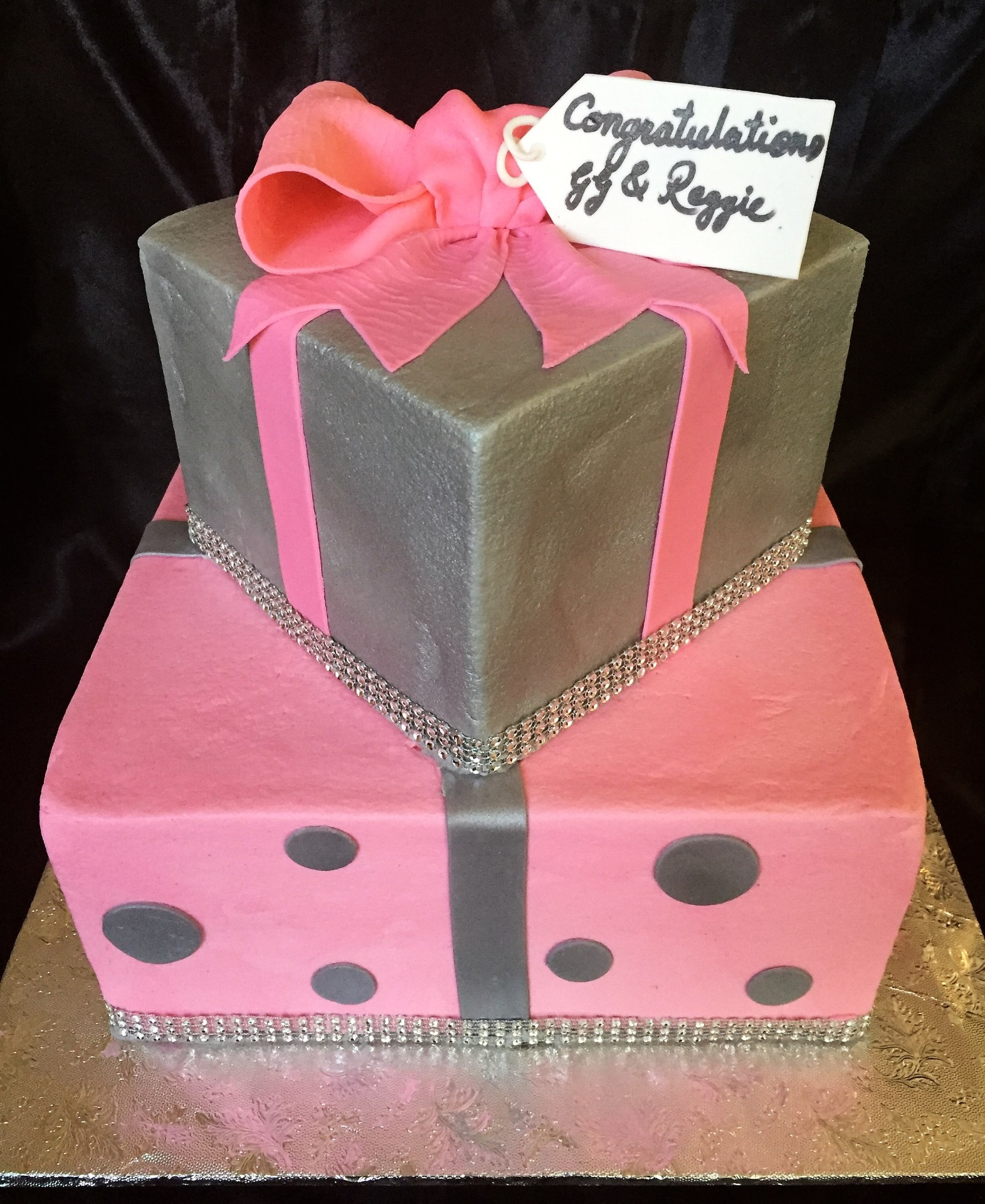 Silver and pink square tiers with bow