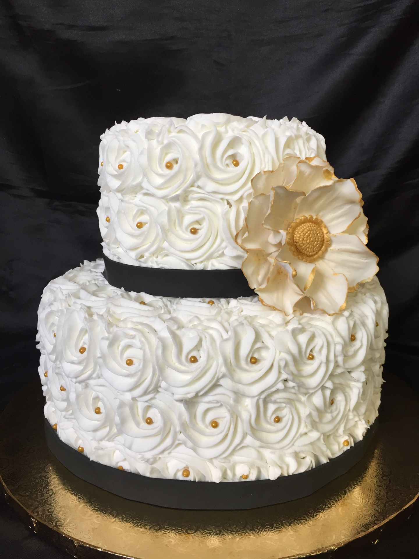 All white rosettes with blakc band