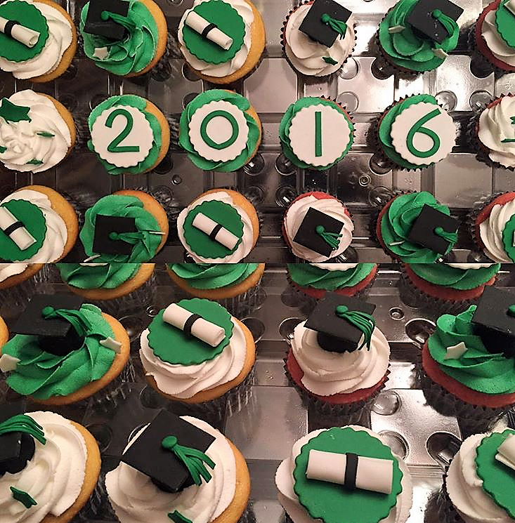 Green and black grad cupcakes with toppers