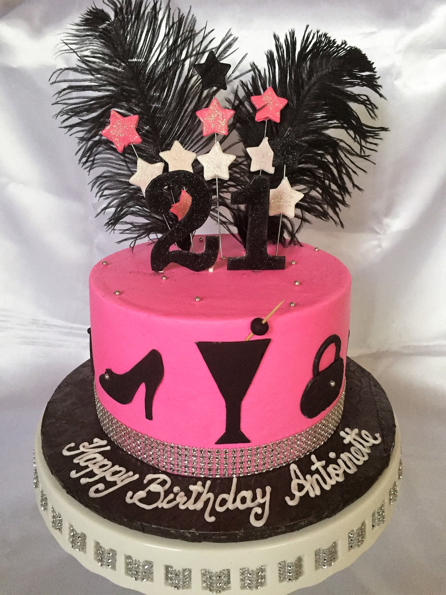 21st Pink with black cutouts and feathers.