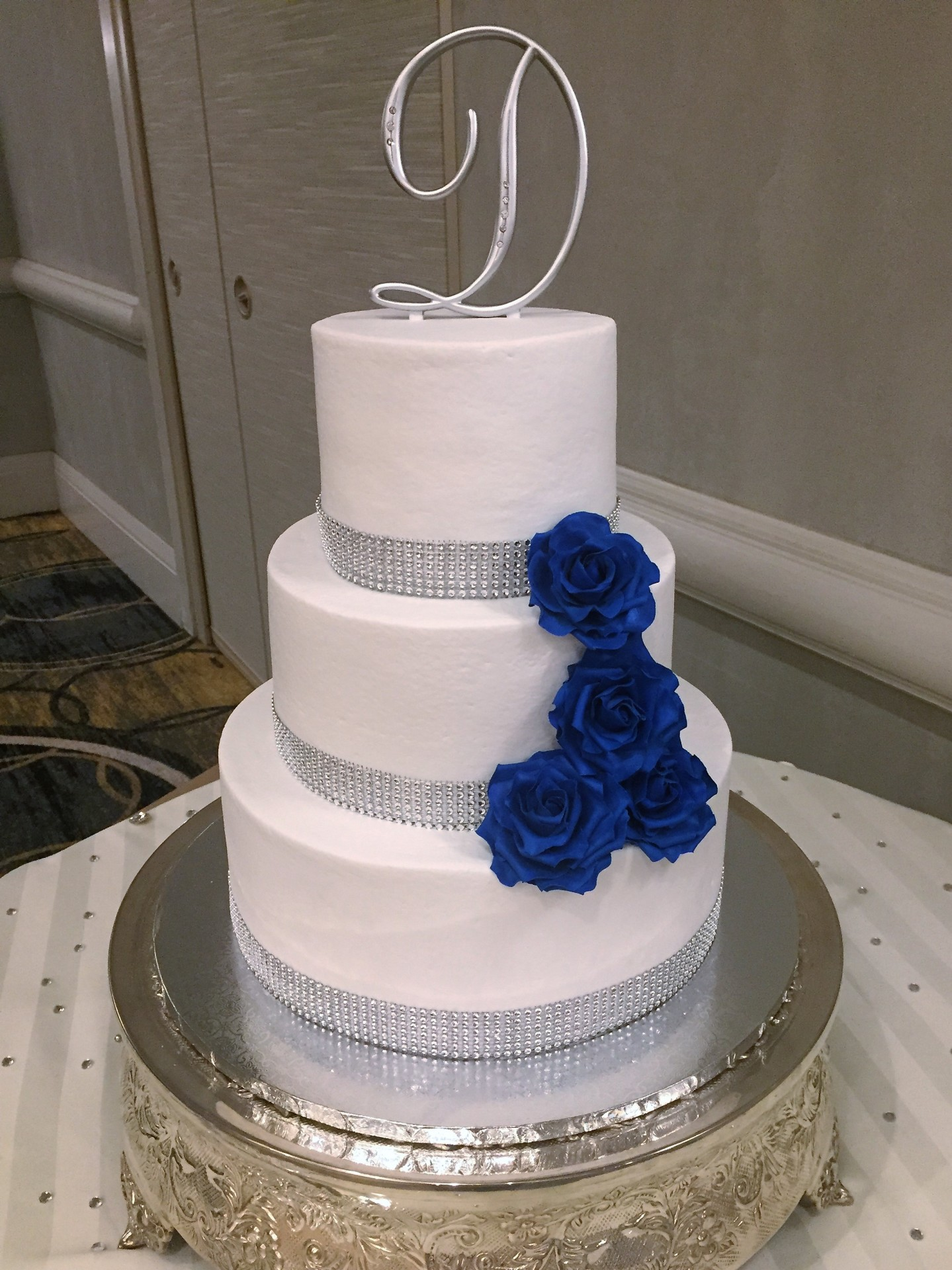 Buttercream with royal blue sugar roses