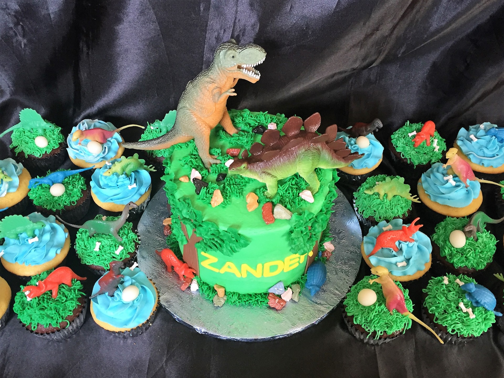 Dino toy toppers cake and cupcakes