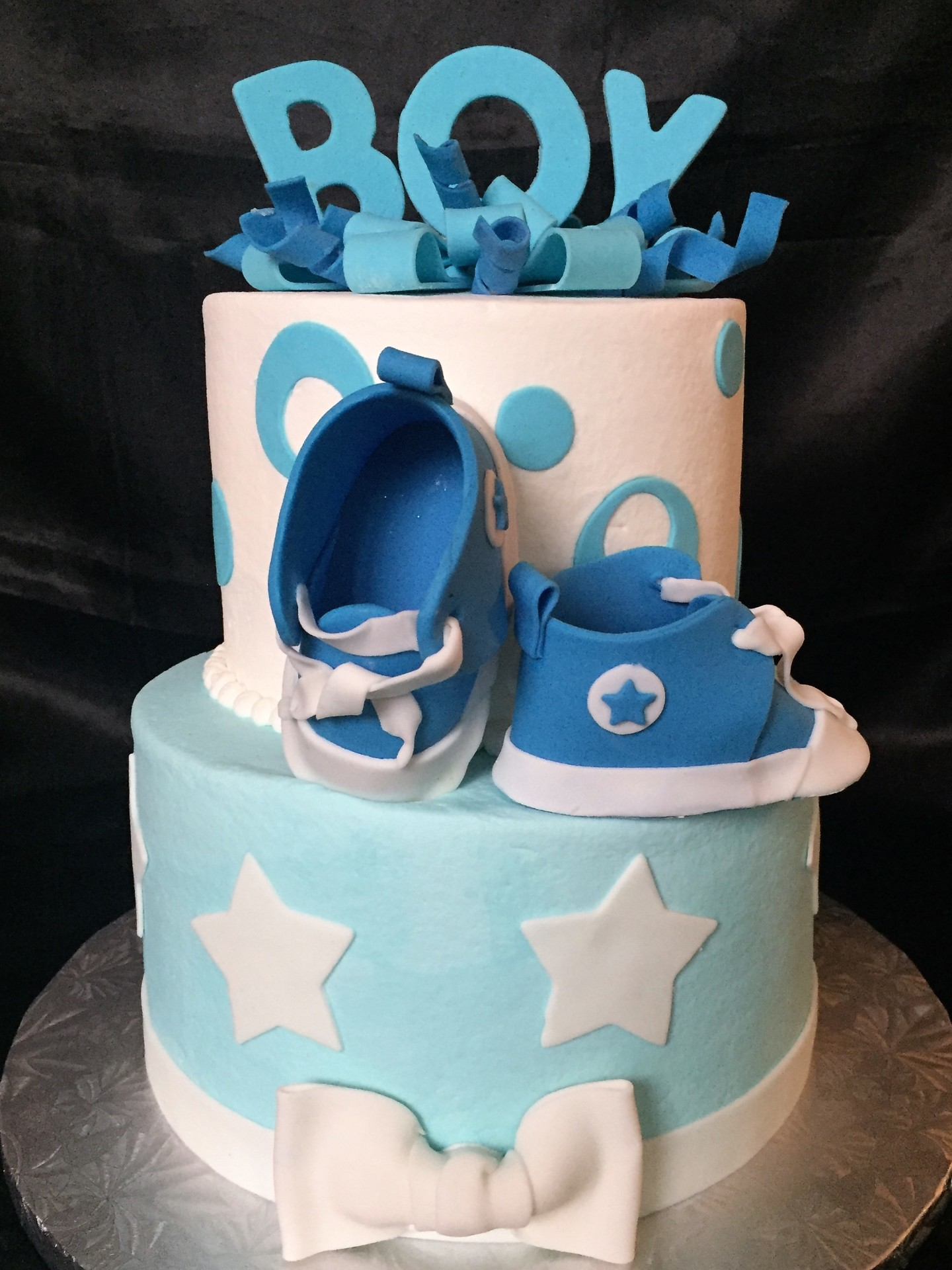 Baby sneakers with 'BOY' topper and bows