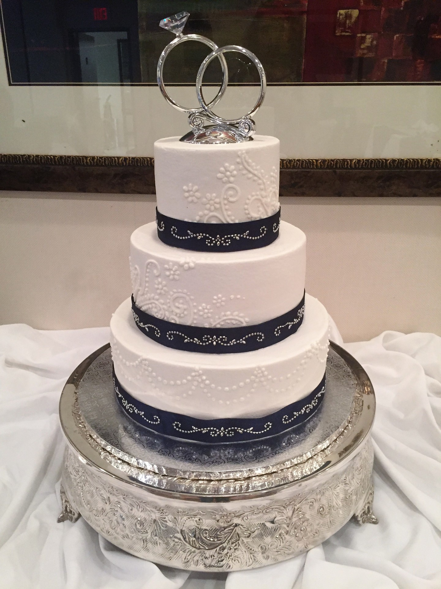 Navy bling band and piping on buttercream