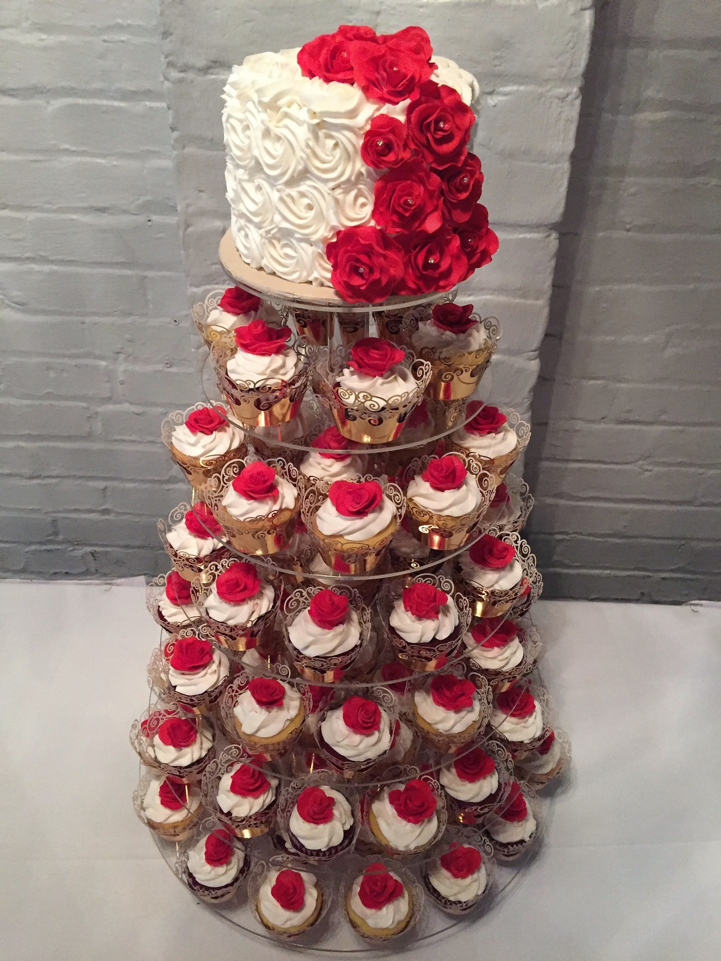 Ivory and gold cupcake tower with red gumpaste roses