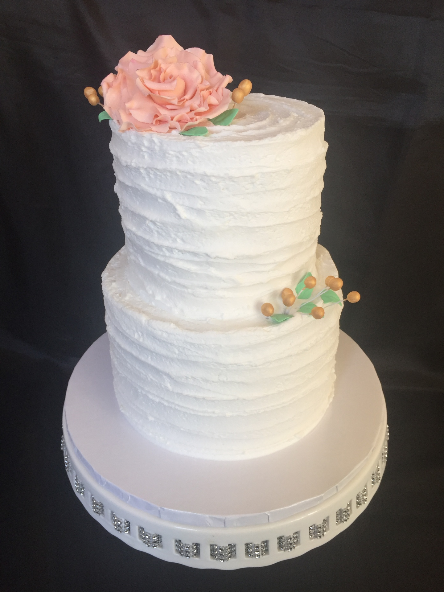 Small rustic cake with peach sugar rose