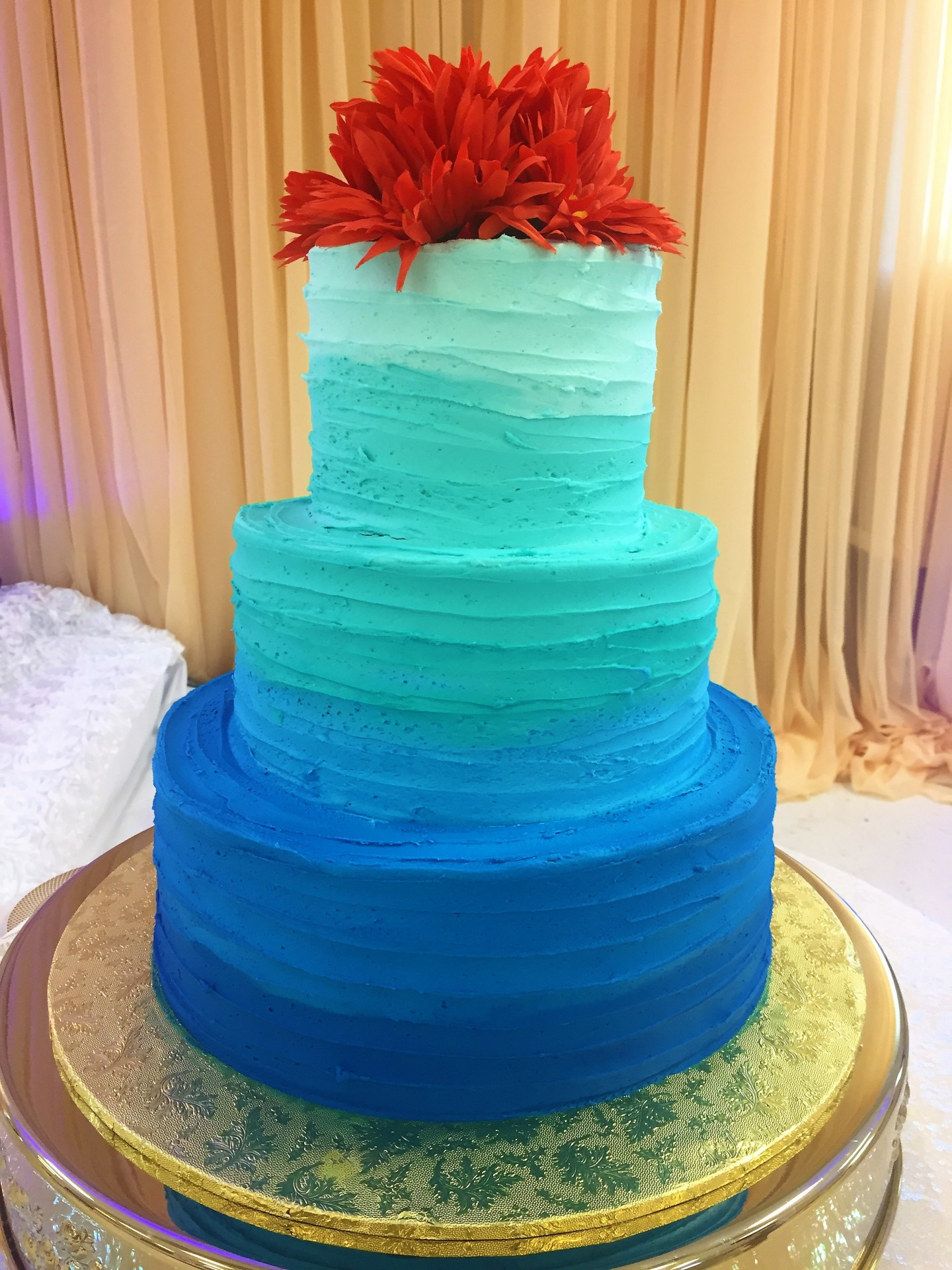 Ombre royal blue and teal rustic finish orange flowers