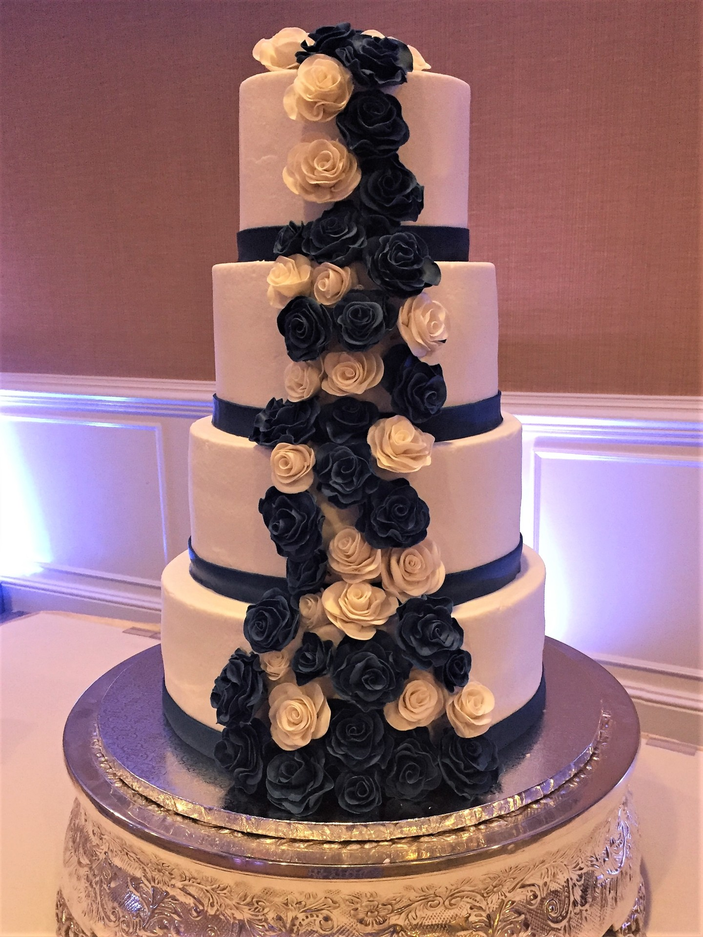 Cascading white and navy roses 4 tier