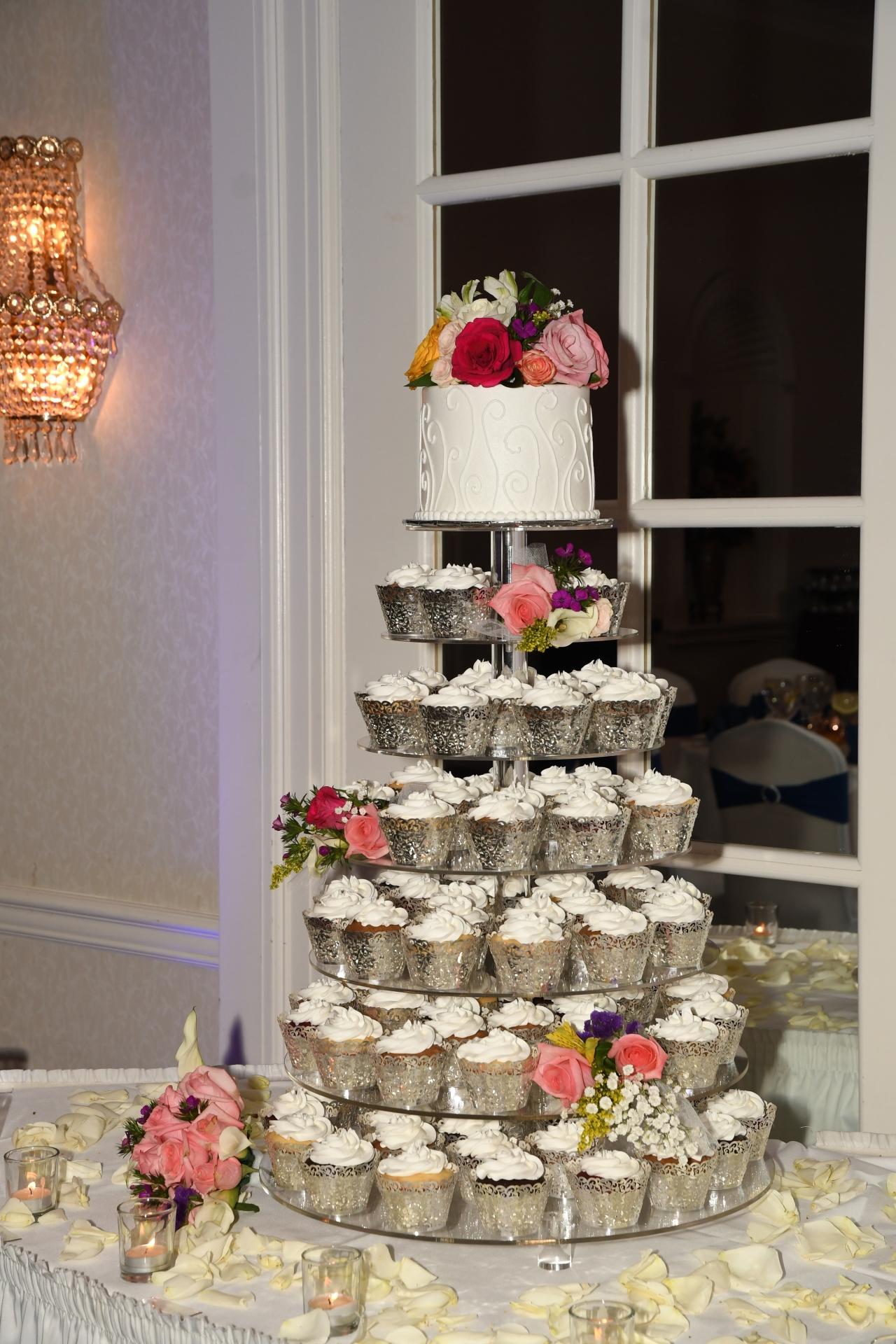 Silver cupcake tower with fresh flowers