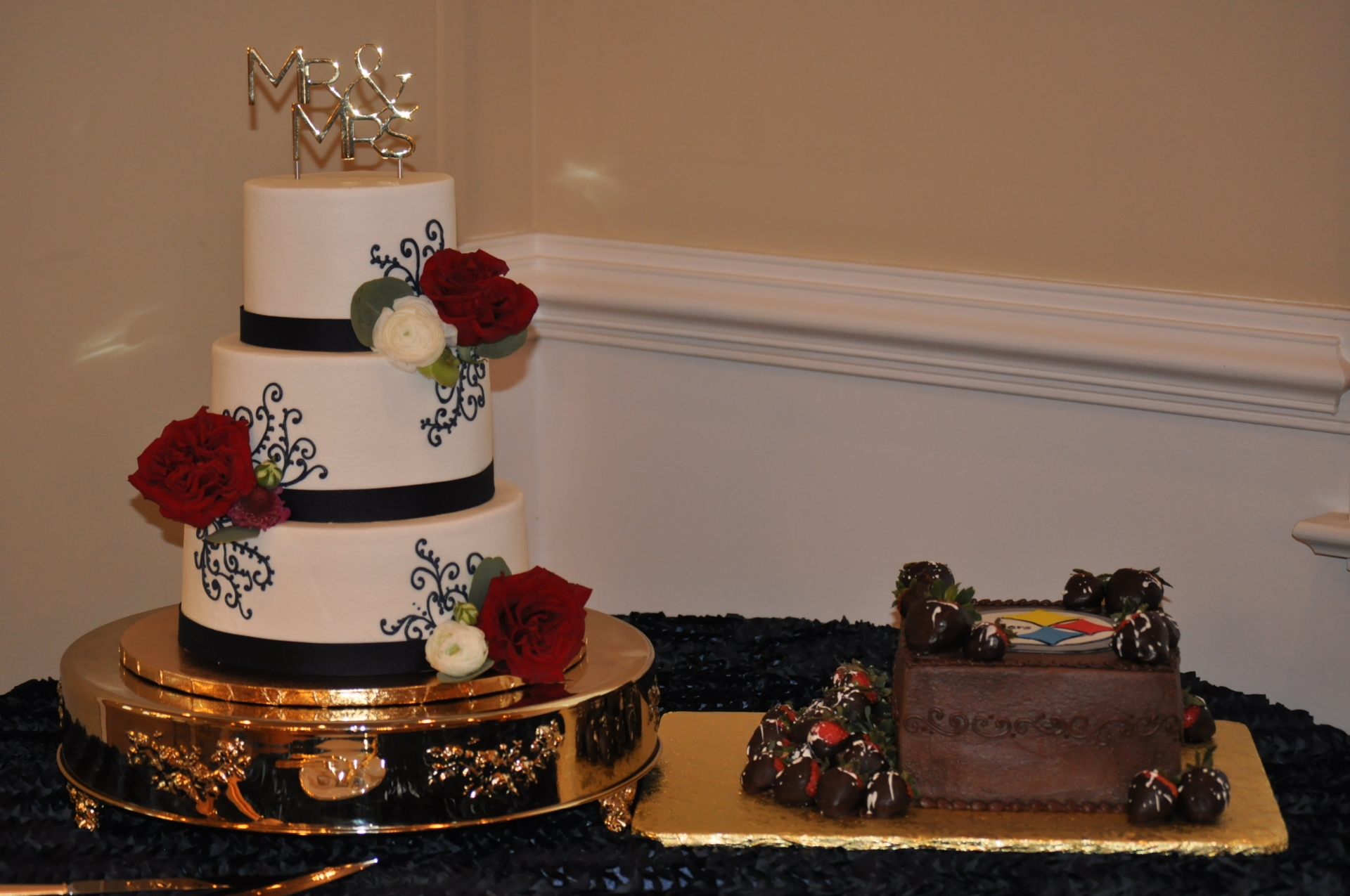 Navy scrolls red roses and Steelers groom's cake