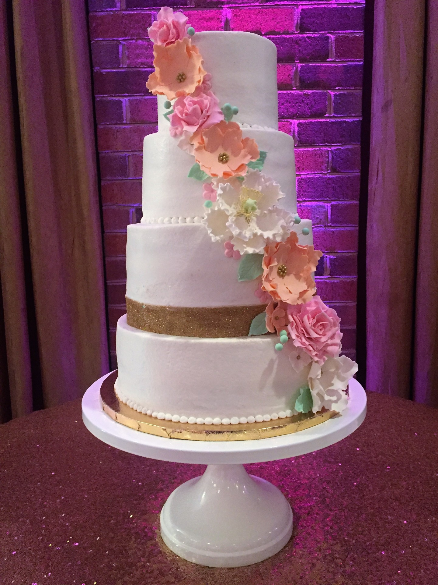 Glitter gold band and cascading sugar flowers