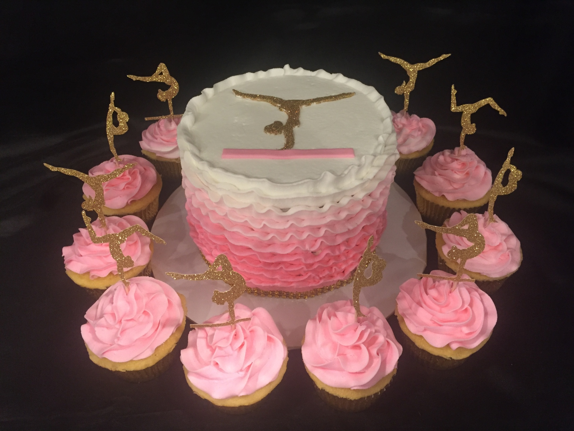 Ombre pink ruffles and gold gymnasts cake cupcakes