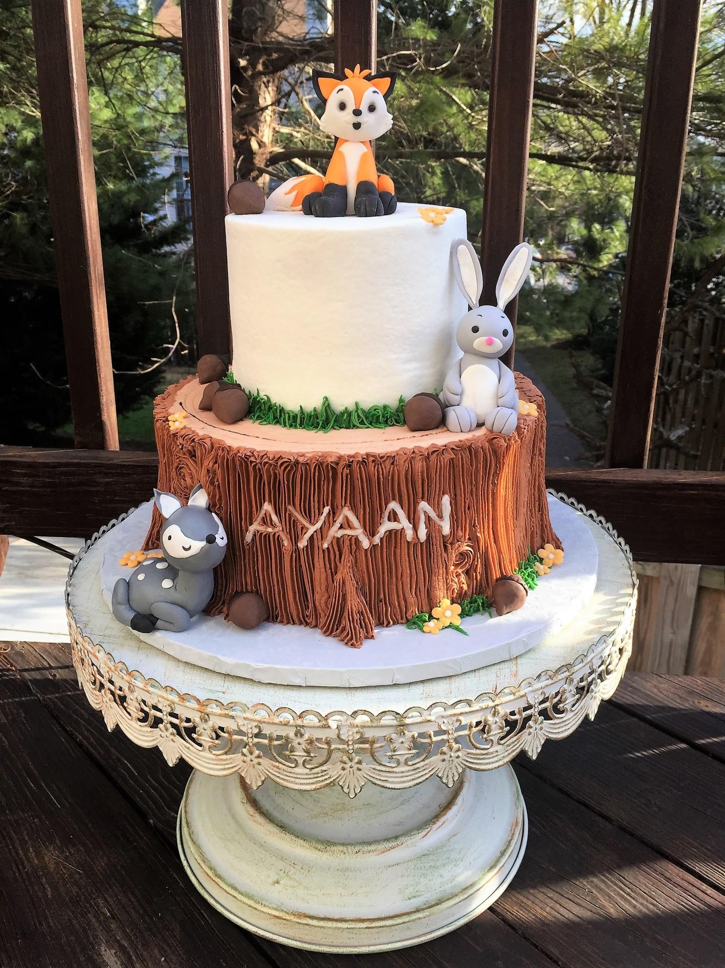 Woodlands theme buttercream cake with fondant animals