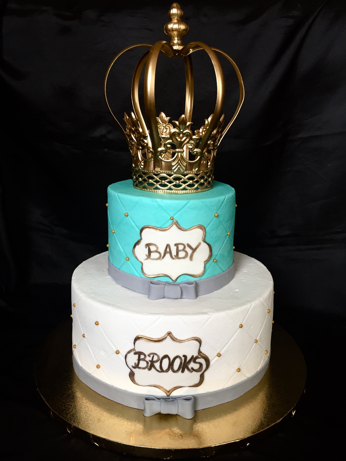 Royal theme teal and gold buttercream with crown