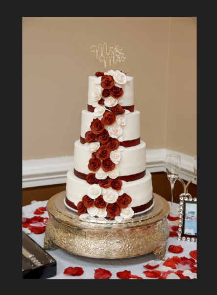 Cascading maroon and white ribbon roses