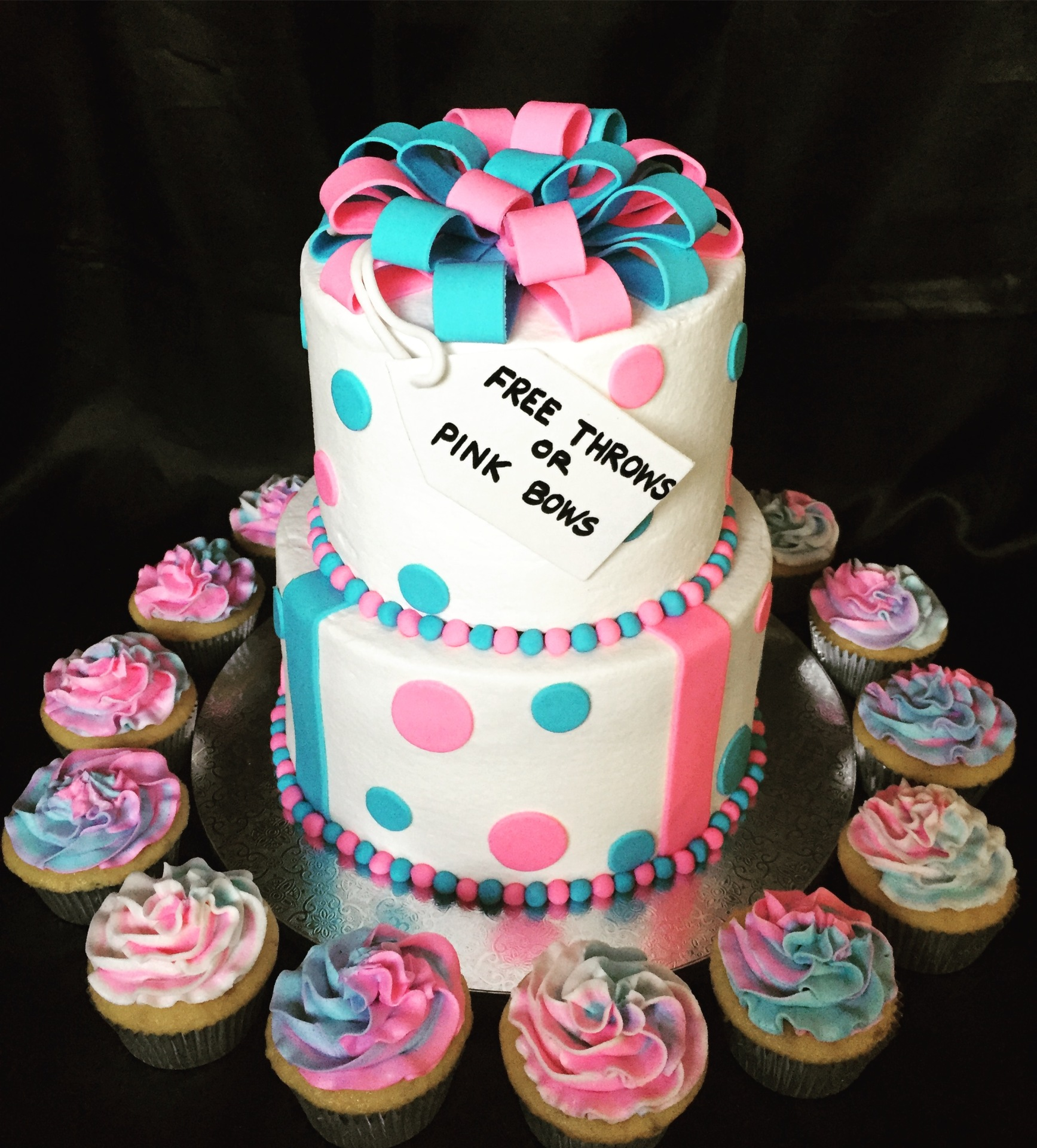 Gender reveal tiered cake and cupcakes