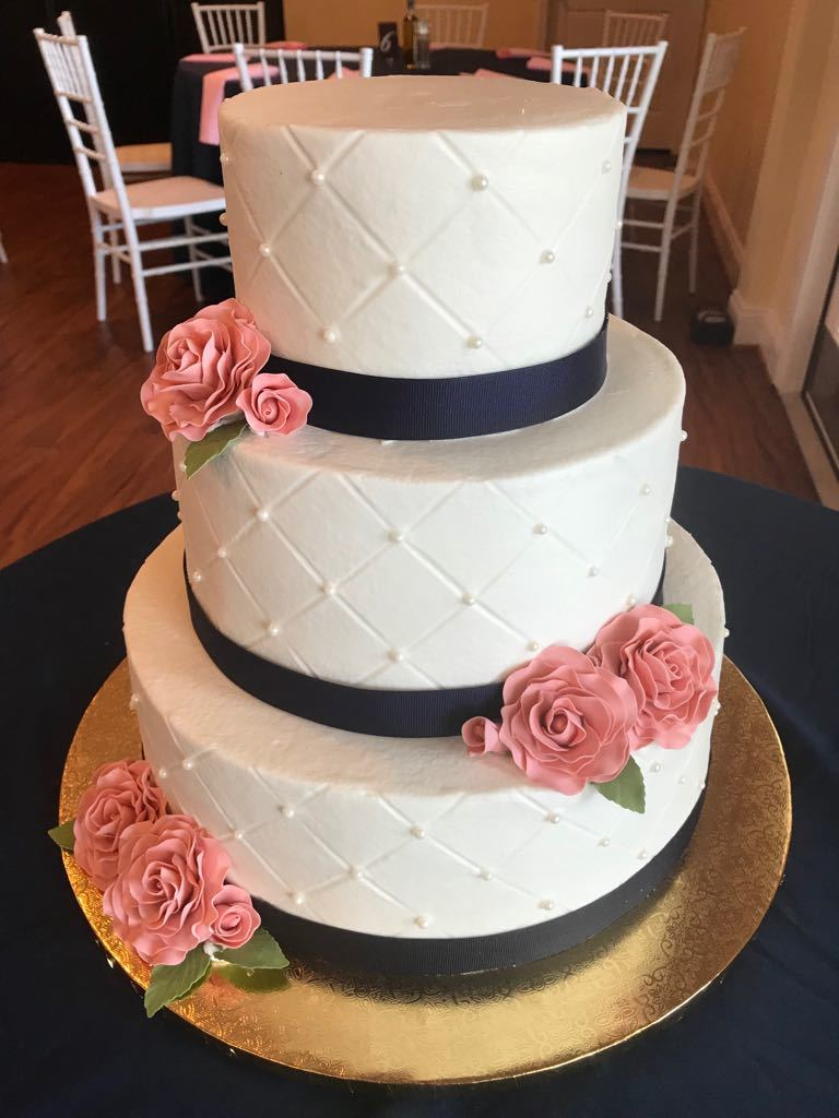 Quilted buttercream with dusty pink sugar roses.
