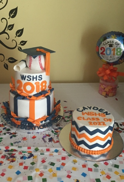 Baseball grad cake with a freshman cake for siblings