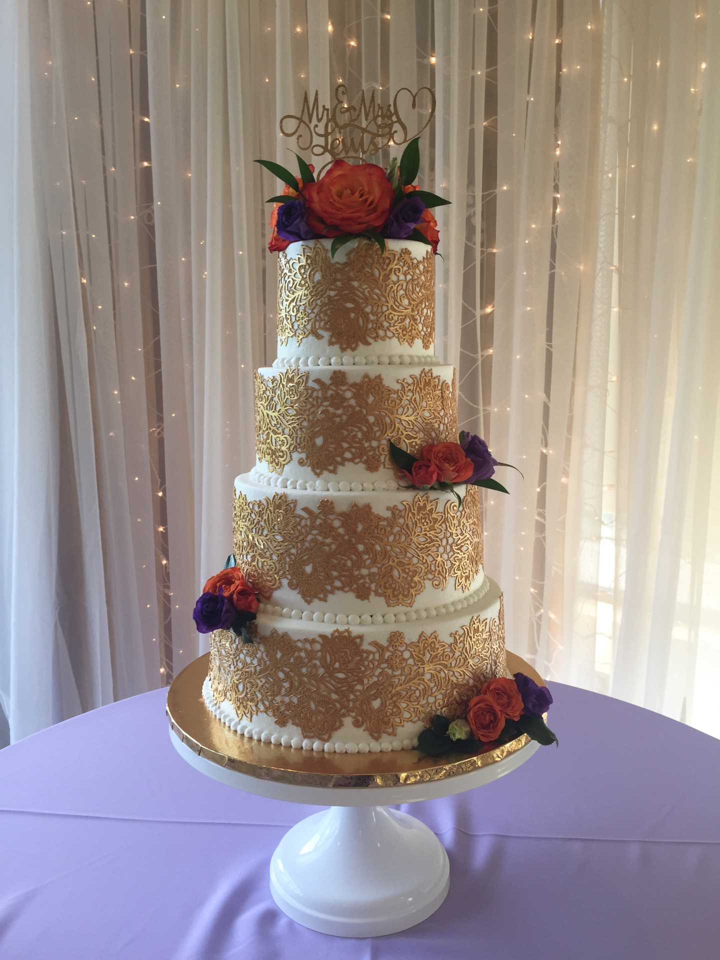 4 tier edible gold lace and fresh flowers