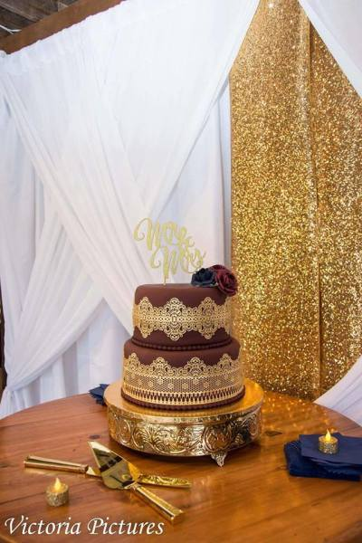 Burgundy fondant with gold lace