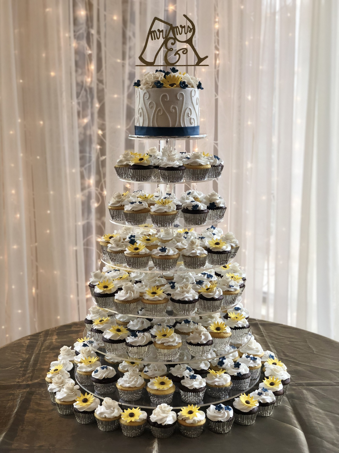 Sugar sunflowers and roses cupcake tower