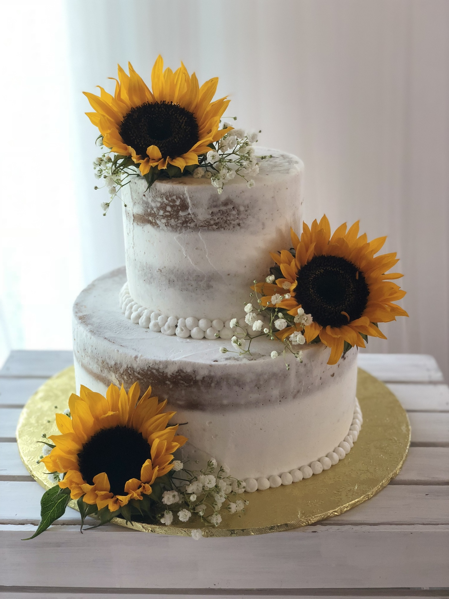 Semi naked rustic cake with fresh sunflowers