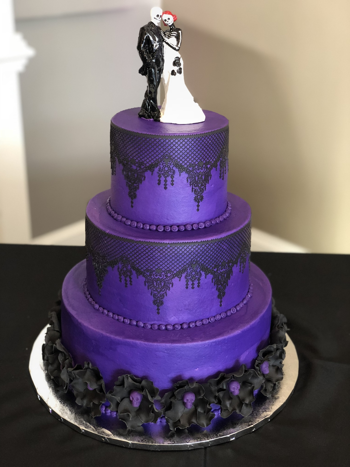 Goth theme- purple buttercream edible lace and sugar flowers
