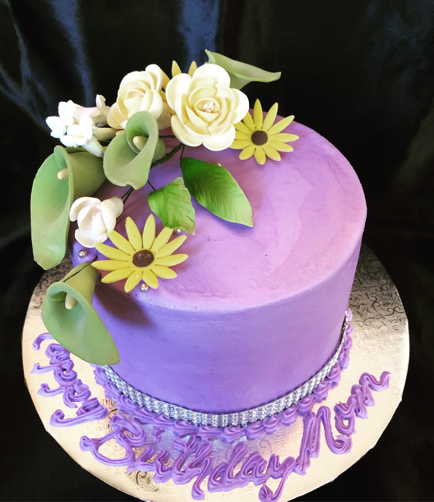 Buttercream cake with gumpaste flower spray