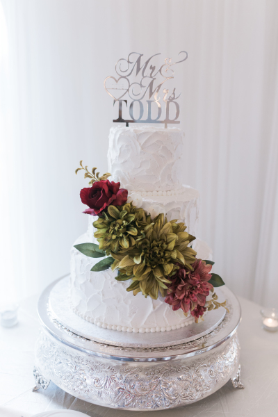 Rustic spackled buttercream with silk flowers