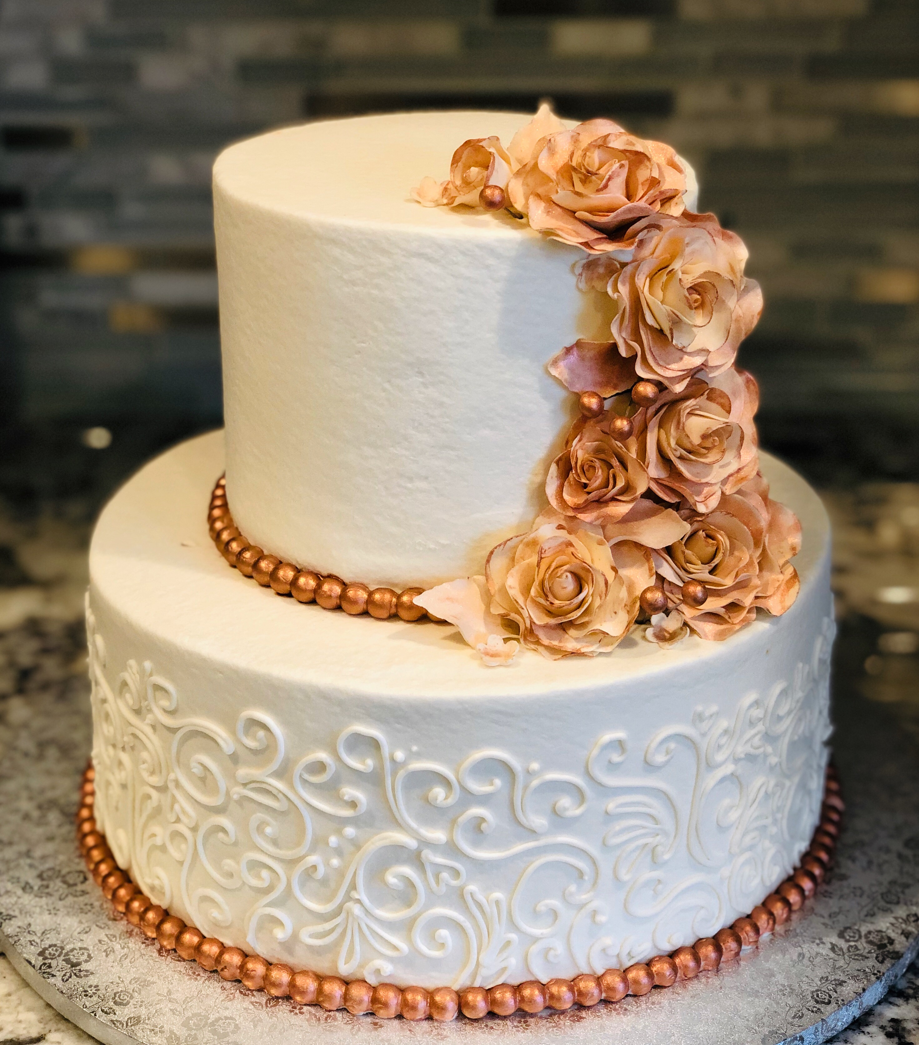 Buttercream scrolls and rose gold sugar roses