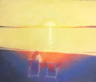 Yellow and Blue Sunset with a couple holding hands in a long chair on the beach