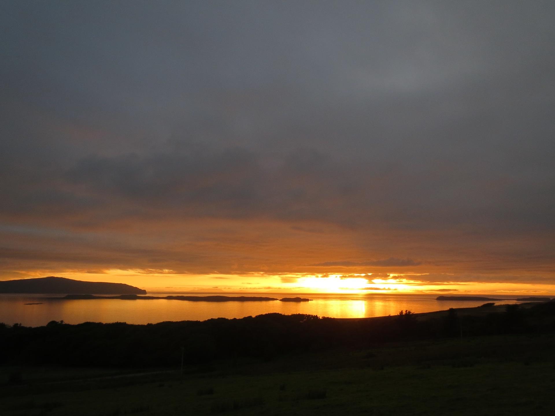 Sun setting into the sea