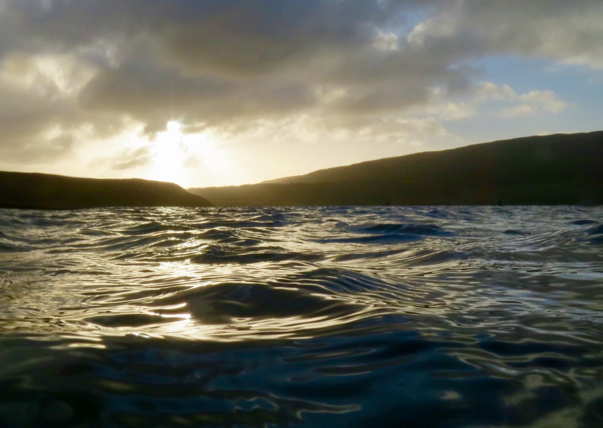 Sunlight on the water from the jetty