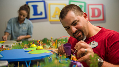 Imagineers Put Final Touches On The Toy Story Land Model For Walt Disney Presents