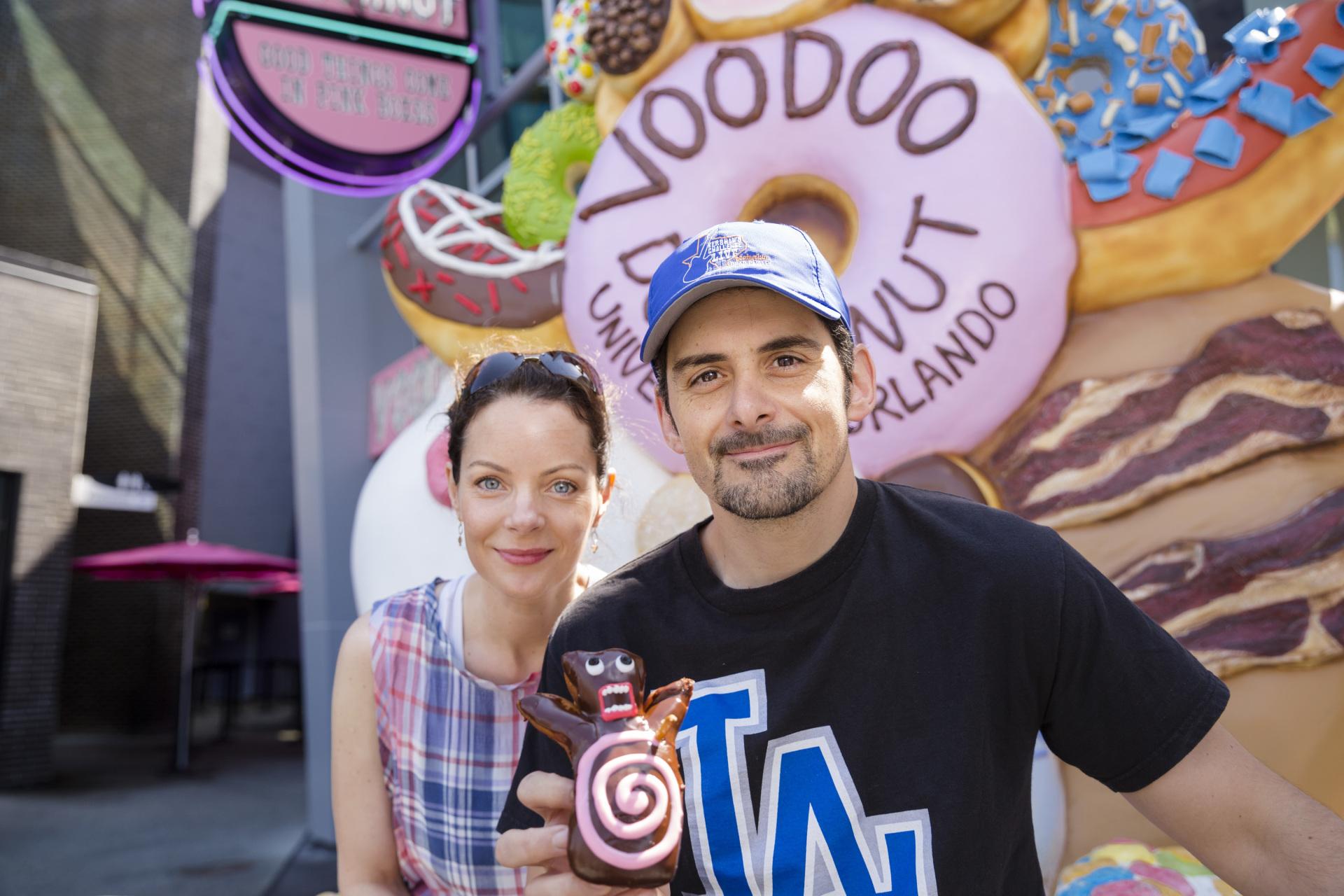 Brad Paisley Enjoys a Voodoo Doll Doughnut at Universal Orlando