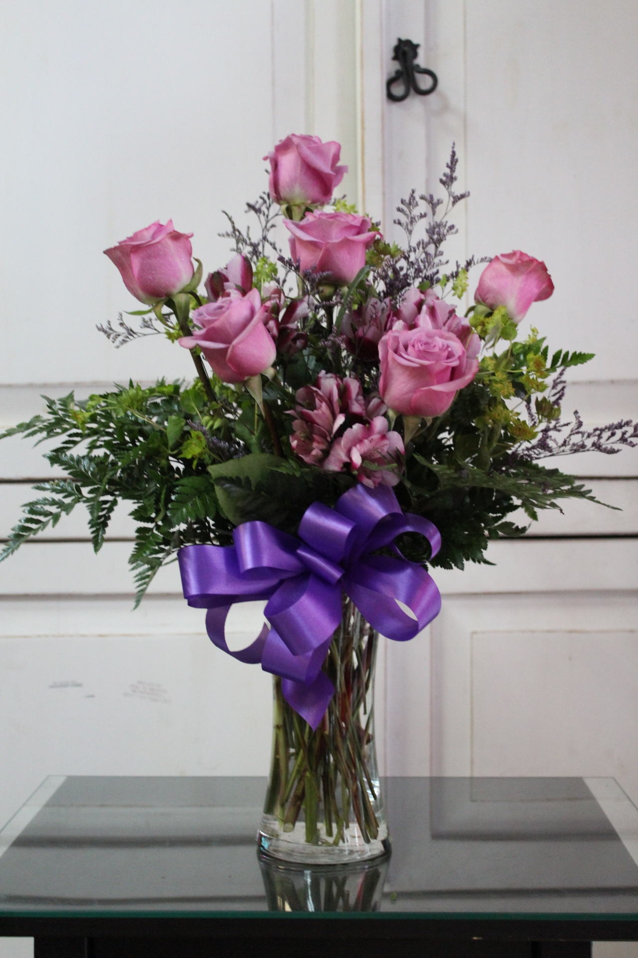 1/2  DZ Purple Roses.  $45.00