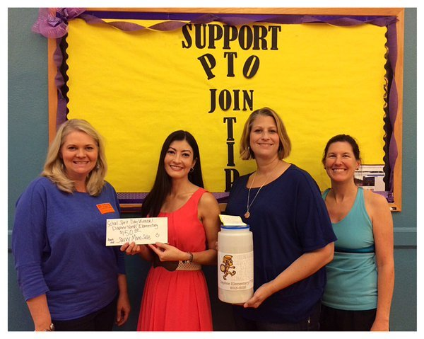 Delivering a $150 check to the Box Top Winners @ Daphne Elementary School