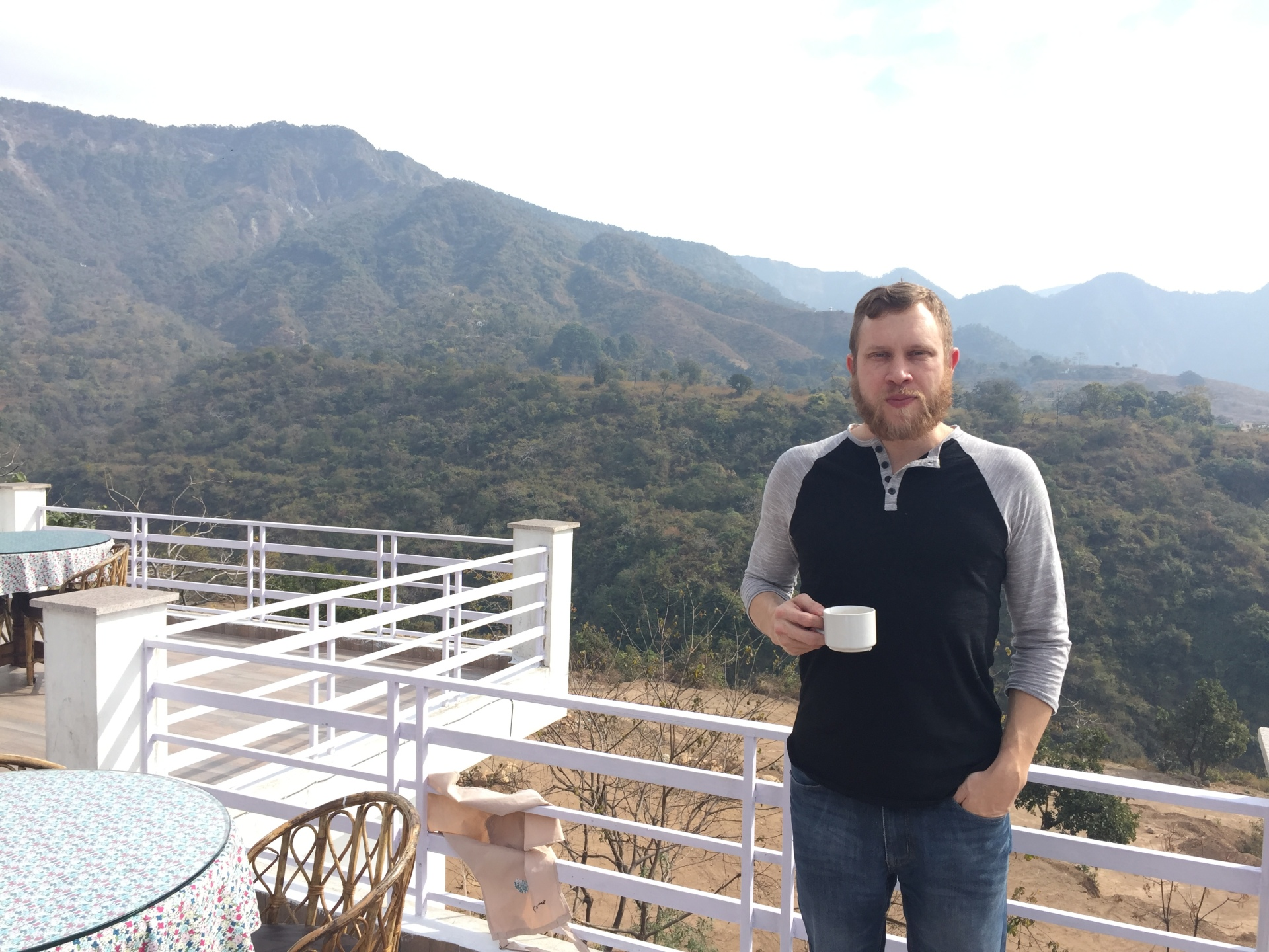 That's me at the coffee shop, with the Himalayas directly behind me.