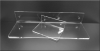 Clear Acrylic and Lucite shelves for wall mounting to display and save space.