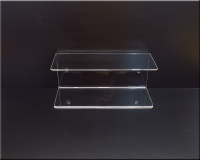 Duel Clear Acrylic wall mounted shelving to add desk top space.