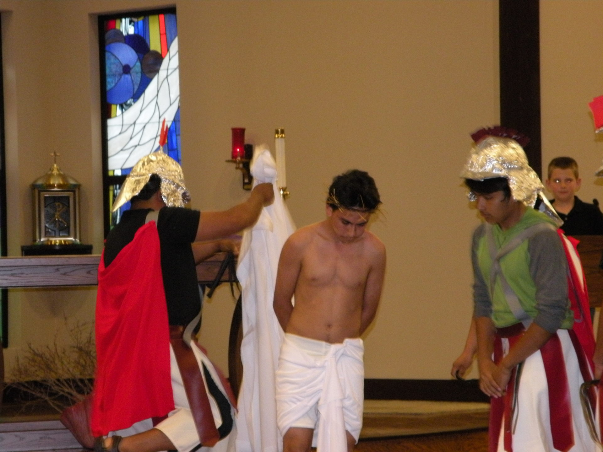 Jesus is stripped of his clothes.
