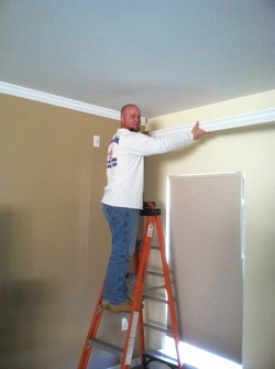 Crown moulding installation by Painting by Rick and Company