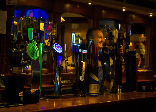 McMahons Bar Maynooth landlord serving at the pumps