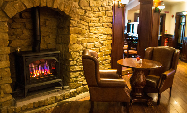 McMahons Bar Maynooth living flame fire and armchairs area
