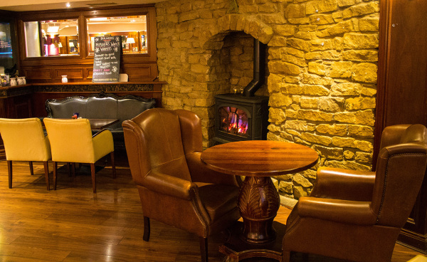 McMahons Bar Maynooth arm chairs beside the cozy fire