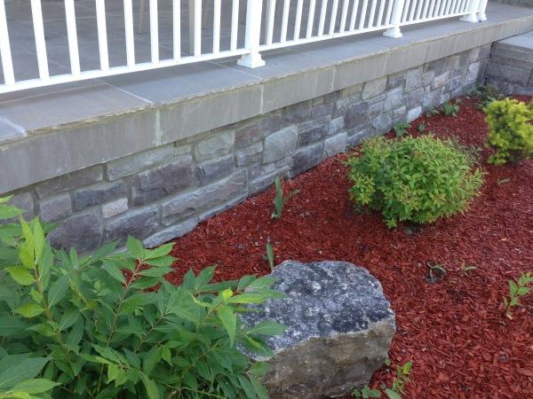 Landscaping Interlocking Stone facing the house